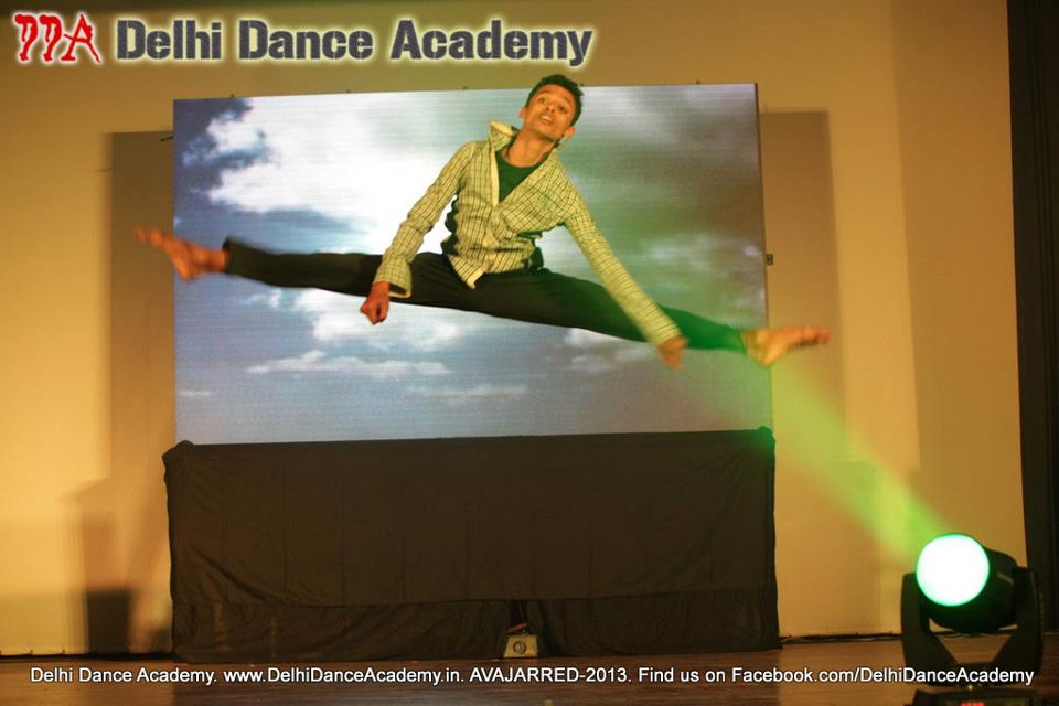 Choreographer Vishnu Swarup doing a jump while one of his contemporary dance performances